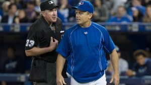 Toronto Blue Jays' Manager John Gibbons, right, has an exchange with home plate umpire Mike Winters after Jays' shortstop Troy Tulowitzki is struck out by Tampa Bay Rays' starting pitcher Drew Smyly in Toronto, Monday, May 16, 2016. (THE CANADIAN PRESS/Chris Young)