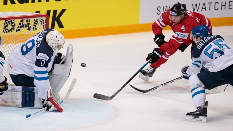 Canada's Taylor Hall, top right, tries to score against Finland's goalie Mikko Koskinen, left, and Atte Ohtamaa during the Ice Hockey World Championships final match between Finland and Canada, in Moscow, Russia, on Sunday, May 22, 2016. (AP Photo / Ivan Sekretarev)