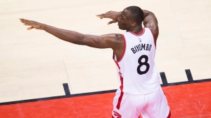 Toronto Raptors centre Bismack Biyombo (8) reacts after making a basket against the Cleveland Cavaliers during second half Eastern Conference NBA basketball playoff action final in Toronto on Saturday, May 21, 2016. (THE CANADIAN PRESS/Nathan Denette)