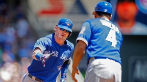 Toronto Blue Jays' Josh Donaldson celebrates his home run against the Minnesota Twins with third base coach Luis Rivera in the first inning of a baseball game Sunday, May 22, 2016, in Minneapolis. (AP Photo / Bruce Kluckhohn)
