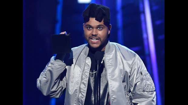 The Weeknd accepts the top 100 artist award at the Billboard Music Awards at the T-Mobile Arena on Sunday, May 22, 2016, in Las Vegas. (Photo by Chris Pizzello/Invision/AP)
