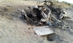 This photo taken by a freelance photographer Abdul Salam Khan using his smart phone on Sunday, May 22, 2016, purports to show the destroyed vehicle in which Mullah Mohammad Akhtar Mansour was traveling in the Ahmad Wal area in Baluchistan province of Pakistan, near Afghanistan's border. (AP Photo/Abdul Salam Khan)