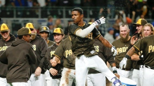 San Diego Padres' Melvin Upton Jr., centre, celebrates after hitting a walk off two run homer against the Los Angeles Dodgers in the ninth inning of a baseball game Friday, May 20, 2016, in San Diego. (AP / Lenny Ignelzi)