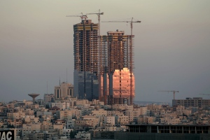 In this Sunday, July 6. 2008 file photo, the sunset reflects on the Jordan Gate Towers under construction in Amman, Jordan. (AP Photo/Nader Daoud, File)