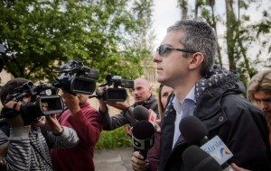 In this May 10, 2016 picture the Dan Condrea, the head of pharmaceutical company Hexi Pharma walks surrounded by media to the prosecutor's office in Bucharest, Romania.(AP Photo/Andreea Alexandru)