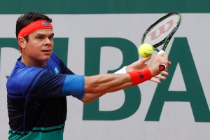 Canada's Milos Raonic returns in his first round match of the French Open tennis tournament against Serbia's Janko Tipsarevic at Roland Garros stadium in Paris, France, Monday, May 23, 2016. (AP Photo/Alastair Grant)