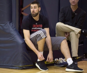 Toronto Raptors Jonas Valanciunas puts his shoes on at practice in Cleveland, Ohio on Wednesday, May 18, 2016. (THE CANADIAN PRESS/Frank Gunn)