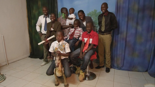 """Robert Matanda, subject of the documentary """"Gun Runners"""" pictured with his family. (Courtesy NFB)"""