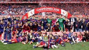 Barcelona poses with the trophy after they won the final of the Copa del Rey soccer match between FC Barcelona and Sevilla FC at the Vicente Calderon stadium in Madrid, Sunday, May 22, 2016. (AP Photo/Daniel Ochoa de Olza)