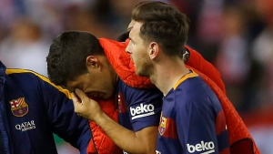Barcelona's Luis Suarez, next to Lionel Messi, reacts as he leaves the pitch during the final of the Copa del Rey soccer match between FC Barcelona and Sevilla FC at the Vicente Calderon stadium in Madrid, Sunday, May 22, 2016. (AP Photo/Francisco Seco)