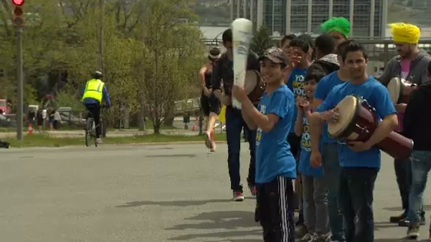 Syrian refugees gathered on the sidelines of the Blue Nose Marathon on Sunday to cheer on the runners.