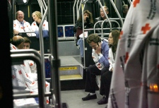Survivors of the US Airways plane crash in the Hudson River wait for a bus to take them from a First Aid center in Weehawken, N.J. back to La Guardia Airport, Thursday, Jan. 15, 2009. (AP / Stuart Ramson)