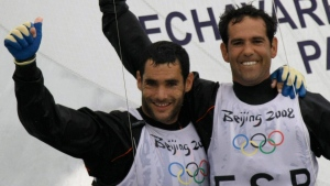 In this file photo, Spain's Tornado crew Fernando Echavarri, right, and Anton Paz react after the medal race of the Tornado class sailing competition of the 2008 Beijing Olympics in Qingdao, about 720 kilometers southeast of Beijing, Thursday, Aug. 21, 2008. (AP Photo / Herbert Knosowski)