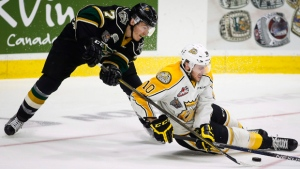 London Knights' Matthew Tkachuk, left, goes after the puck with Brandon Wheat Kings' Kale Clague during third period CHL Memorial Cup hockey action in Red Deer, Monday, May 23, 2016. (Jeff McIntosh / THE CANADIAN PRESS)