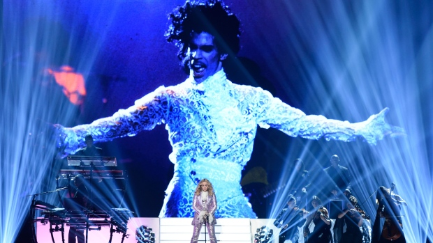 Madonna performs a tribute to Prince, pictured onscreen, at the Billboard Music Awards at the T-Mobile Arena on Sunday, May 22, 2016, in Las Vegas. (Photo by Chris Pizzello/Invision/AP)