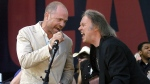 In this July 2, 2005, file photo, Gord Downie of The Tragically Hip (left) and Neil Young perform during the finale of the Canadian Live 8 concert in Barrie, Ont. (Aaron Harris/The Canadian Press via AP, File)