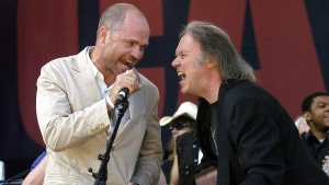 In this July 2, 2005, file photo, Gord Downie of The Tragically Hip (left) and Neil Young perform during the finale of the Canadian Live 8 concert in Barrie, Ont. (Aaron Harris / The Canadian Press via AP)