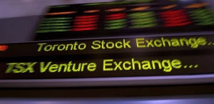 A TSX ticker is shown in Toronto on May 10, 2013. ( Frank Gunn / THE CANADIAN PRESS)