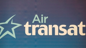 An Air Transat logo is shown during the unveiling of the new interior design of Transat jets in Montreal, Thursday, May 17, 2012. (THE CANADIAN PRESS/Graham Hughes)