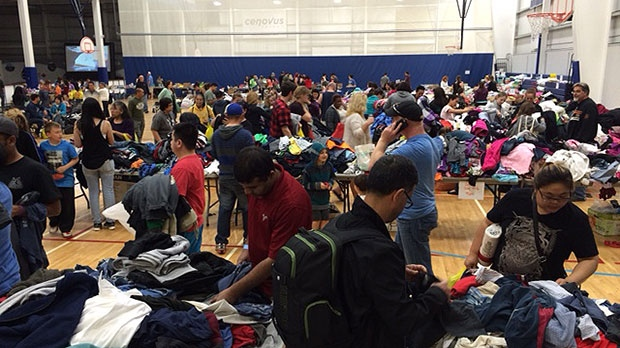 Evacuees from Fort McMurray pick up supplies and clothing at the evacuation centre in Lac la Biche.