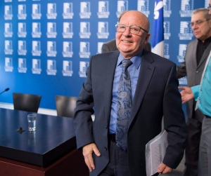 Former Parti Quebecois transport minister and spokesman for the taxi industry, Guy Chevrette smiles after he reacted to a legislation regulating the taxi industry in Quebec City, Thursday, May 12, 2016. (Jacques Boissinot / THE CANADIAN PRESS)
