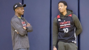FILE - DeMar DeRozan and Toronto Raptors head coach Dwane Casey talk at practice in Cleveland, Ohio, on Wednesday, May 18, 2016. (THE CANADIAN PRESS/Frank Gunn)