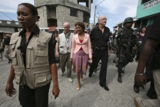 Canada's Governor General Michaelle Jean, center, walks in Bel-Air neighborhood in Port-au-Prince, Saturday, Jan. 17, 2009. (AP Photo / Ariana Cubillos)