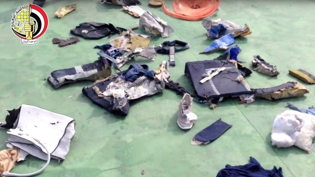 This file still image taken from video posted Saturday, May 21, 2016, on the official Facebook page of the Egyptian Armed Forces spokesman shows some personal belongings and other wreckage from EgyptAir flight 804 in Egypt. (Egyptian Armed Forces via AP, File)