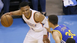 Oklahoma City Thunder guard Russell Westbrook is defended by Golden State Warriors guard Stephen Curry during the first half in Game 4 of the NBA basketball Western Conference finals in Oklahoma City on Tuesday, May 24, 2016. (AP / Sue Ogrocki)