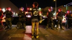 Riot police block off the Albuquerque Convention Center to anti-Trump protests following a rally and speech by Republican presidential candidate Donald Trump at the convention center where the event was held, in Albuquerque, N.M. on Tuesday, May 24, 2016. (AP / Brennan Linsley)
