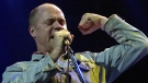 The Tragically Hip lead singer Gord Downie performs during the Music Without Borders Live in Toronto Sunday, October 21, 2001. (THE CANADIAN PRESS/Aaron Harris)