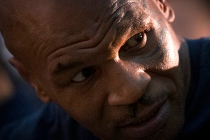 Former heavyweight boxing champion Mike Tyson listens to a person seated next to him during a panel discussion held before the 2016 IBF World Championship Bout at the National Tennis Center in Beijing, Wednesday, May 25, 2016. (AP Photo/Mark Schiefelbein)