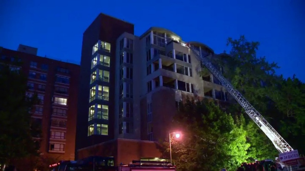 Firefighters at an eight-storey apartment building