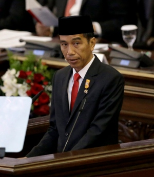 In this Aug. 14, 2015 file photo, Indonesian President Joko 'Jokowi' Widodo delivers his speech before Parliament. (AP / Tatan Syuflana)