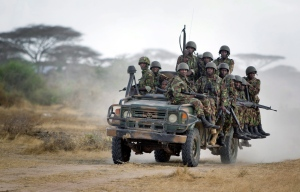In this Monday, Feb. 20, 2012 file photo, Kenyan army soldiers ride on a vehicle at their base in Tabda, inside Somalia. (AP / Ben Curtis)