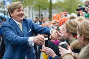 In this April 27, 2016 file photo, Dutch King Willem-Alexander shakes hands of well-wishers during King's Day celebrations in Zwolle, Netherlands. (AP / Frank van Beek, Pool)