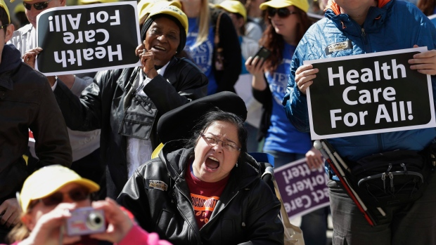 Protesters march on the Texas capitol to demand that lawmakers expand access to health care, in Austin, on March 5, 2013. (AP Photo/Eric Gay)