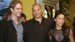"""In this June 18, 2001 file photo, from left, Paul Walker, Vin Diesel, and Michelle Rodriguez, arrive at the world premiere of """"The Fast and the Furious,"""" in the Westwood section of Los Angeles. (AP Photo/Chris Weeks)"""