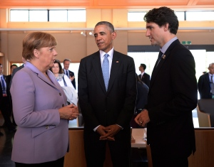 Prime Minister Justin Trudeau, right, talks with German Chancellor Angela Merkel, left, and U.S. President Barack Obama as they visit the Ise Grand Shrine (Ise Jingu) in Ise, Japan during the G7 Summit on Thursday, May 26, 2016. (THE CANADIAN PRESS/Sean Kilpatrick)