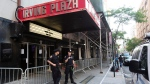 Police officers stand outside Irving Plaza, on May 26, 2016 in New York. (Mark Lennihan / AP)