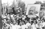 In this Sept. 14, 1966 file photo, youths are seen at a rally during the height of the Red Guard upheaval waving copies of the collected writings of Communist Party Chairman Mao Zedong, often referred to as Mao's Little Red Book and carrying a poster of Karl Marx.  (AP)