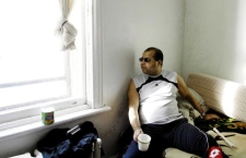 Abdelkader Belaouni in his room in the ministers house next to St. Gabriels Church, Point St. Charles, in Montreal, Saturday Jan. 5 2008. (THE CANADIAN PRESS / Graham Hughes)