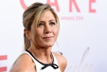 In this Jan. 14, 2015, file photo, Jennifer Aniston, a cast member in 'Cake,' poses at the premiere of the film at Arclight Cinemas in Los Angeles. Aniston announced the death of her mother, Nancy Dow, in a statement to People magazine on May 25, 2016. (Photo by Chris Pizzello/Invision/AP, File )