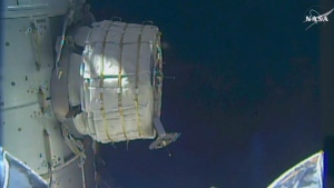In this frame from NASA TV, a new experimental room at the International Space Station partially inflates on May 26, 2016. (NASA TV via AP)