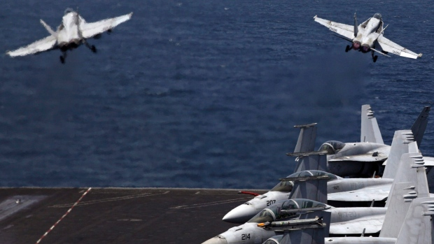 In this Monday, Aug. 11, 2014 file photo, F/A-18 fighter jets take off for mission in Iraq from the flight deck of the U.S. Navy aircraft carrier USS George H.W. Bush in the Persian Gulf. (AP Photo/Hasan Jamali)