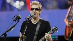 In this Nov. 24, 2011 file photo, Nickelback lead vocalist Chad Kroeger and his band perform during halftime of an NFL football game between the Detroit Lions and the Green Bay Packers in Detroit. (AP Photo / Carlos Osorio, File)