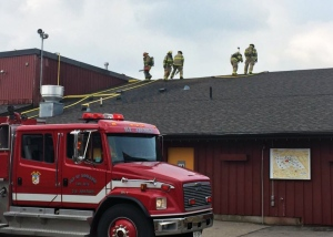 Firefighters battle a fire at the Peddlers' Village building in the St. Jacobs Farmers' Market on Thursday, May 26, 2016. (Mike Schmiedtke / Twitter)