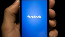 The Facebook app is seen in this undated file photo. (AFP / BRENDAN SMIALOWSKI)