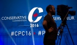 A television cameraman sets up at the Conservative Party of Canada convention in Vancouver, Thursday, May 26, 2016. (Jonathan Hayward / THE CANADIAN PRESS)