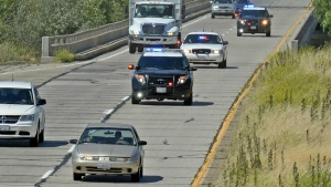 California Highway Patrol units pursue a car being sought in a statewide Amber Alert in the disappearance of a Northern California 15-year-old girl, as it passes through Buellton on U.S. Highway 101 in Southern California on Thursday, May 26, 2016. (Mike Eliason / Santa Barbara County Fire Department)